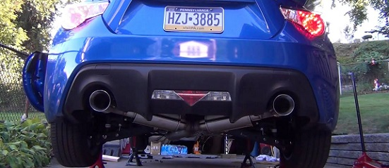 Header-back exhaust systems