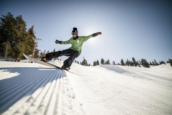 Riding a park snowboard