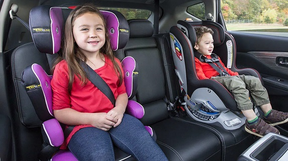 picture of two kids in a car on their car seats
