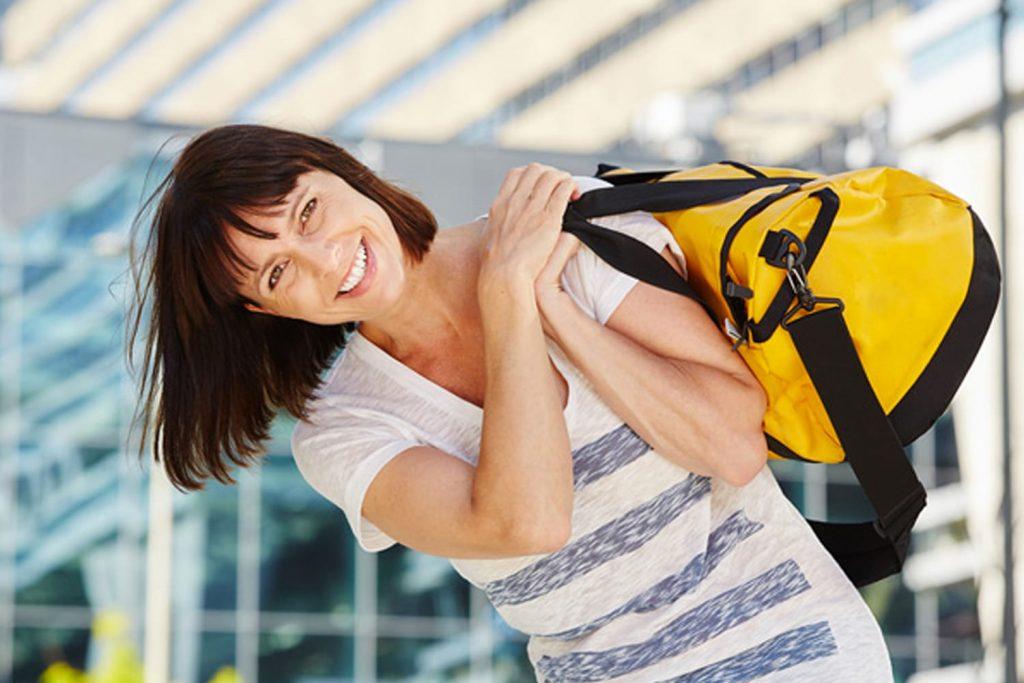 holding duffel bag