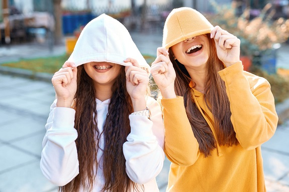 Teenage girls in hoodies