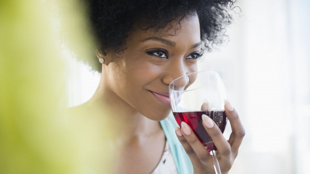 african-american-woman-drinking-glass-of-wine