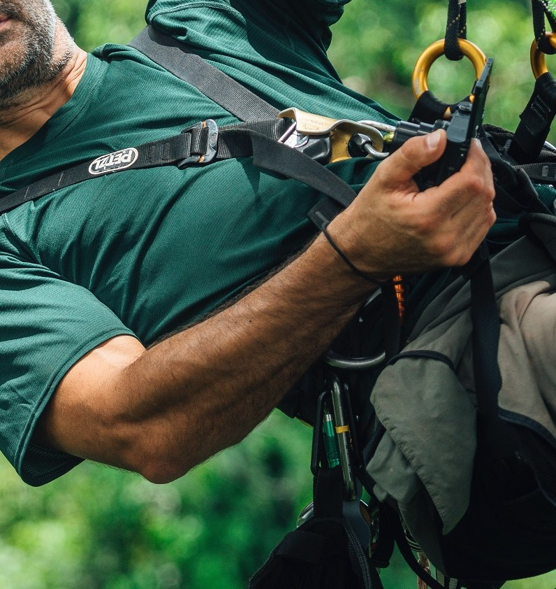 man climbing with a harness