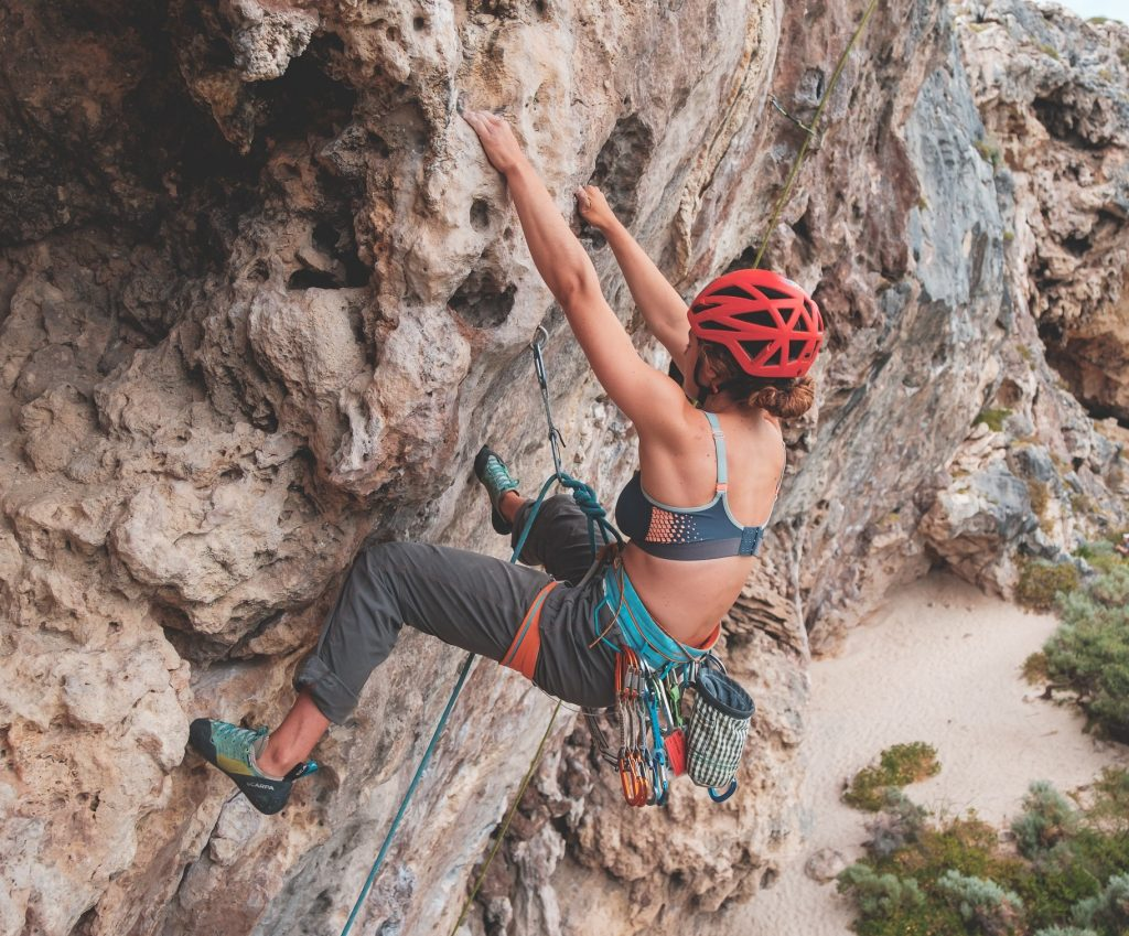 woman with a helmet climbing