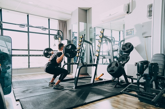 men working out with barbells in gym